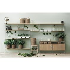 String panels form the basis for the entire String shelving system. String side panels are mounted on the wall using screws, and they can be combined with the shelves and other elements of String System in numerous different ways. Furniture, Shelves, Living Dining Room, Led Furniture, White Paneling, Flooring, Living Room Inspiration, Home And Living, Shelving