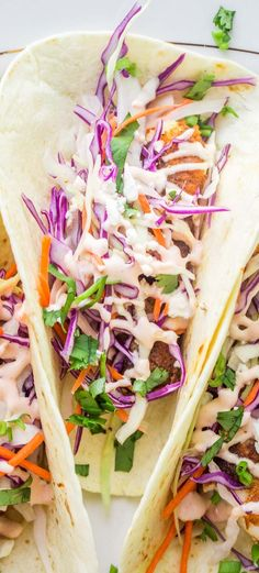 EASY Fish Tacos Recipe with Cabbage Slaw – Valentina's Corner An amazing fish taco recipe that is ready in under 20 minutes! Crispy blackened fried white fish (tilapia or cod) topped with a crunchy cabbage slaw and a spicy fish taco sauce. Fish Taco Cabbage Slaw, Slaw For Fish Tacos, Fried Fish Tacos, Tilapia Tacos, Spicy Fish Tacos, Blackened Fish Tacos, Easy Fish Tacos, Salmon Tacos, Blackened Salmon
