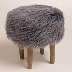 Featuring a plush charcoal gray faux fur top inspired by the flokati wool shag rugs of Greece, our fun and modern hardwood footstool is ideal…