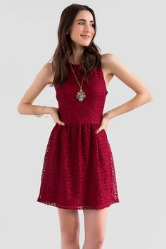 "The Leight Lace Dress is so easy to dress up or down!  A beautiful burgundy floral lace covers this sleeveless fit & flare dress. Style with heels & a statement necklace for a special occasion or a denim jacket & booties for a casual look.<br />  <br />  - 33"" length from shoulder to hem<br />  - 36"" chest<br />  - 30"" waist<br />  - 58"" sweep<br />  - measured from a size small<br />  <br />  - 100% Polyester<br />  - Machine Wash<br />  - Made in U.S.A.<br />  <br />"