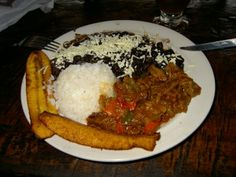Pabellon criollo: Follow link for Carnegie Achada recipe and then figure out how to do it in a crockpot on the 365 blog.  While no kitchen, nuke the black beans and grill the plantains?   Or pick those up from Chubbys.... Hmmmm....