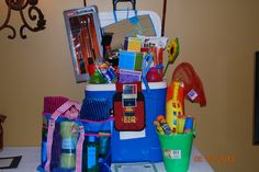 """""""Summertime Fun Raffle"""" Contains: 60 Qt Igloo Cooler, Gift Cards from area Restaurants, Movie Theater, etc, Large Beach Bag, 4 Beach Towels, Beach Mat, Sunscreen Lotion, Lip Balm, Aloe Vera, Grill-out Items, BBQ Tool Set, BBQ Towel & Mitt, Slip-n-slide for Kids, Beach Bucket with Toys, 2 Cane Fishing Poles, Picnic Tablecloth, Bottled Water, Drinks, Snacks etc. (A Take-along Grill with Charcoal would be another great idea for this basket) Also paper plates, cups etc"""