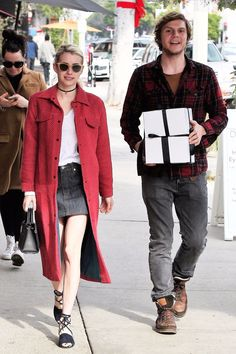 These Christmassy Photos of AHS's Emma Roberts and Evan Peters Are Slightly Disorienting