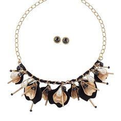 Modern Pearlesque Petal Necklace and Earring Set. The Modern Pearlesque Collection plays up the rhinestones tassels and pearl-like accents set in goldtone.