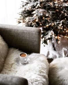 Hot drink in hand, all snuggled up by the Christmas tree. Does it get better than this?