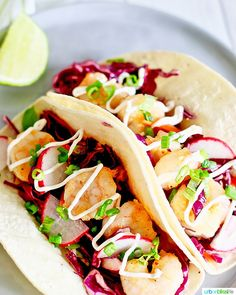 These Easy Shrimp Tacos are perfect for Taco Tuesday, Cinco de Mayo, or for any busy weeknight dinner! Make them in 30 minutes or less, with just a few ingredients. Packed with yummy flavors and textures, you'll love these tacos! Get the recipe on UrbanBlissLife.com #shrimp #tacos #shrimptacos #tacotuesday #cincodemayo #recipes #easyrecipes #Mexicanfood #healthyfood #healthyrecipes Shrimp Taco Recipes, Shrimp Tacos, Fish Recipes, Mexican Food Recipes, Healthy Recipes, Ethnic Recipes, Carrot Slaw, Shrimp Dishes