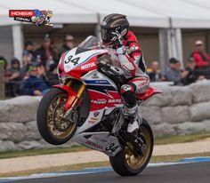Team Honda's Josh Hook celebrates his maiden Superbike win at Phillip Island today.