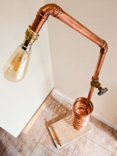 Tall Copper Floor Lamp - Floor Lamps -   Tall Copper Floor Lamp Floor Light, Reading Lamp, CD Rack. Urban Chic Floor Lamp hand crafted with up-cycled copper pipe with brass and galvanised steel fittings. Set on an industrial, reclaimed timber base. Steampunk, offbeat design, made in our workshop in England. Height: 120cm Width:... #Bedroom #Copper #Design #Edison #Farmhouse #Floorlamp #Huge #Industrial #Metal #Recycled #Steampunk #Vintage
