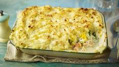 This posh fish pie combines smoked haddock, salmon and prawns, homemade parsley sauce and a cheesy mashed potato topping. Bbc Good Food Recipes, Pie Recipes, Seafood Recipes, Cooking Recipes, Savoury Recipes, Dinner Recipes, Savoury Dishes, Yummy Recipes, Hardboiled
