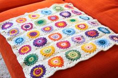 Hey everyone! Once upon a time I made a Sunburst Granny Square blanket for my niece, took some pictures and posted them on my old blog...