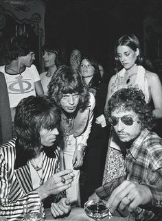 Keith Richards, Mick Jagger, and Bob Dylan at Jaggers 29th birthday party, July 1972 in New York City