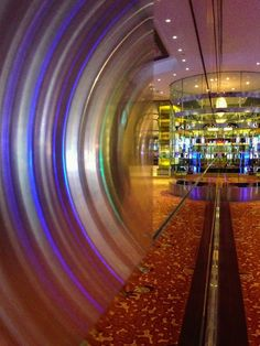 I cannot explain how this happened I can only explain what I did that resulted in this happening.  Still in The Mirage, there is a long wall of mirrored glass along the front of the buffet.  I steadied the phone against the glass expecting to get a mirror image of whatever was opposite the glass.  I did get some of that, but I also got this vortex closest to the camera.  It reminds me of a lens…. I don't know.  The lens is not up against the glass, it is on the opposite side.  I do know I…