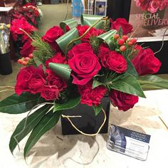 Love this design. Super stylish- This was for a table arrangement for a panel discussion for AARP.  #florist #flowers #flowershop #mmflowers #winter #red #christmas #roses #princeton #nj #plainsboro #princetagram #aarp