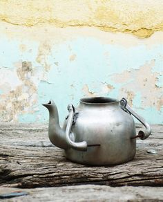 old tea kettle----I wish I still had the one I had like this.  I found it on a hike , it had a bullet hole through it, I planted a plant in it.