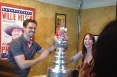 This baby is NOT impressed by the Stanley Cup...  Puck Daddy - Yahoo! Sports