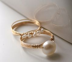 Freshwater pearl wrapped in gold filled wire. This is a matching set, so you get two rings. Set of Gold Pearl Rings Freshwater pearls wire-wrapped stacking rings --- have some pearls from my Dad when he was in Korea . Pearl Jewelry, Wire Jewelry, Beaded Jewelry, Pearl Rings, Jewlery, Wire Earrings, Leather Jewelry, Bridal Jewelry, Diy Schmuck
