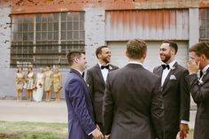 Navy blue for the groom and classic black for the groomsmen. Love how you can see the girls in gold in the background! #groom #groomsmen #weddingday #weddingphotography #weddingcoordination // Melissa Green Photography // Leslie Herring Events