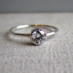 .50 carat round brilliant diamond ring - like simple design. Maybe a flatter band though?