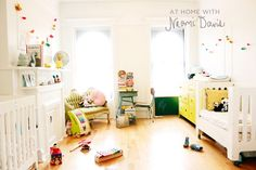 "At Home With Naomi Davis, nursery.  ""The nursery is often quite a mess, since Eleanor and Samson like to empty all the books out of the baskets and aren't very keen on ""clean up"" time. But the room is well-lived-in, and I am grateful for all the tiny messes they like creating. :) """