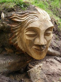 Green man carving, via Flickr.