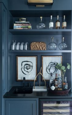 Blue den wet bar pai Blue den wet bar painted in Benjamin Moore Abyss features a blue cabinet fixed beside a glass front wine cooler positioned under a black quartz countertop finished with a black sink and matte black faucet. Architecture Restaurant, Bar Cart Decor, Built In Bar, Modern Farmhouse Design, Farmhouse Style, Blue Cabinets, Glass Cabinets, Farmhouse Remodel, Bar Areas