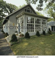 SUNROOMS: Front of small grey stucco bungalow, addition of sunroom, border garden along house with shrubs and flowers, View Large Photo Image Enclosed Porches, Screened In Porch, House With Porch, House Front, Bungalows, Porch Kits, Porch Ideas, Sunroom Addition, Building A Porch