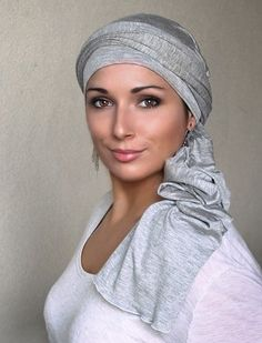 Light Gray Heather Turban Head Wrap (One Piece) $50 says it is not a scarf and for people who have trouble tying scarves, but doesn't explain if it's a slip on or a partially sewed head cover- turban diva