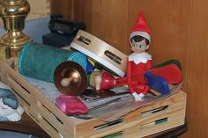 "Elf on the Shelf 2010 (Fizzy): 12/03: Fizzy our Elf making music in ""Band in a Box."" Photo by G."