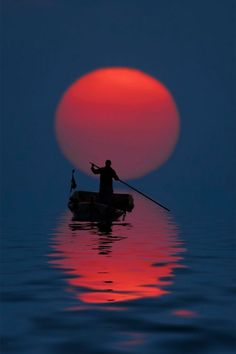 //Fisherman at Sunset (China) ... Peacefully crossing the Styx at dusk? Transcendental harmony and perfection. Let it be.(Endless Seas) #breathtaking #photography ... #Photo #Photography #Nature #NaturePhotography #Landscapes #Sunsets