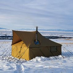 The Cadillac of tents:  wall tent by Montana Canvas, with a wood stove, and window!