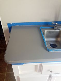 Toy Hauler Travel Trailer Renovations - Painting the Laminate Countertops...step by step instructions, including dry times and mention of a coating to go over countertop paint. PLAN AHEAD! each coat requires a three day dry time before adding another coat....VERY IMPORTANT...or will be left with a sloppy mess... Mdb