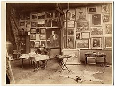 Alfred Roll in his studio, painting.