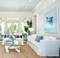 A classic, crisp white living room with livable slipcovered furniture, pops of blue and the perfect accents. Beach House Furniture, Living Room Decor Furniture, Coastal Furniture, Home Furniture, Coastal Living Rooms, Home Living Room, Furniture Slipcovers, Cottage Ideas, Furniture Collection