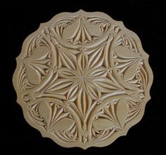 The patterns of chip carving are geometric designs incised into flat wooden surfaces. Chip carving is surprisingly easy to learn and requires only one or two knives. The work is portable, done on one's knee, at home or away.