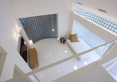 A renovated home for two families  by Yasunari Tsukada