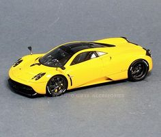 """Spark S3564 2012 Pagani Huyara Yellow 1:43 Scale Car 1:43 Scale Resin, approximately 4.25"""" long Spark Model Includes Display Case Part # S3564"""
