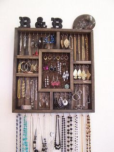 Shadowbox jewelry organizer used to display all types of jewelry. Comes with a removable cork board to organize your stud earrings. 19 inches wide20 inches tall2 5/8 inches deep58 stainless steel hooksEbony stain colorJewelry not included.May be returned within thirty days of purchase. However, buyer must cover return shipping costs.