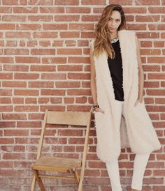 The Penny Famous Long Shaggy Fur Vest features the softest shaggy faux fur with a sleek satin lining. Sleeveless open front and two generous side pockets.