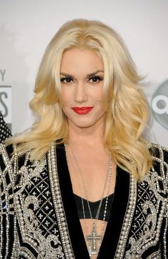 pretty gwen stefani...staying true to her signature red lipstick and liquid black liner, and completing her look with a classic blowout, 2012.