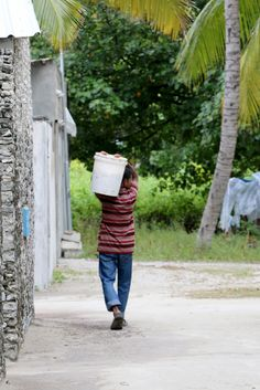 A local man carrying something on his back #Maldives #tradition #carry