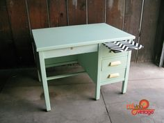 I love this vintage desk so much! The mint green color is gorgeous, and that zig zag pull out board adds the perfect pop! Wish I could afford it.