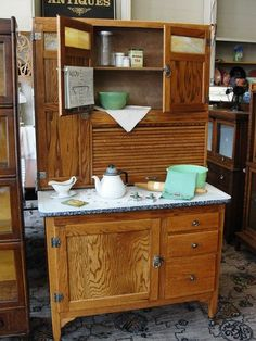 1920 Sellers Oak Kitchen Cabinet with Porcelain Top.      I have my Grannie's Hoosier Cabinet (completely refinished) & it looks just like this!