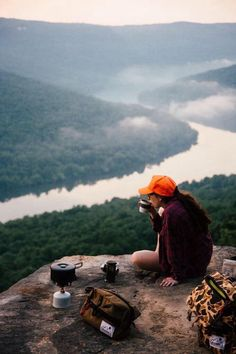 The happiness found from enjoying a warm drink and looking over a winding river, alone and contemplating life.