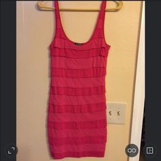 """EXPRESS - HOT PINK MINI DRESS SIZE XS ONLY USED ONCE! Just a bit wrinkled from being folded - needs a low iron.  EXPRESS HOT PINK MINI DRESS WITH 3/4 INCH STRAPS  Perfect for a night out dancing! Can be worn alone as a mini dress or with leggings and heels!  Super soft & stretchy material from their """"Dreamweight Cotton"""" collection.  ORIGINAL PRICE $49.50  Offers accepted! No lowball offers please. Thanks :) Express Dresses Mini"""