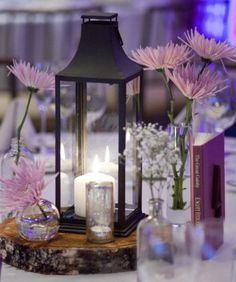 rustic centerpiece with lantern wood coin and medicine bottle