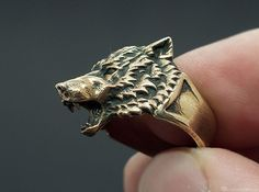 Wolf Head Ring 3d printed Blackened polished brass. You get the ring without blackening, but you can do it yourself