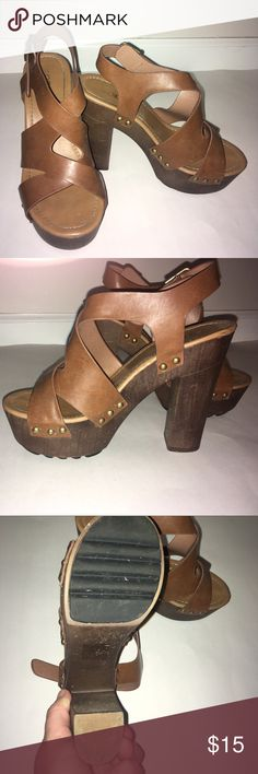 Nordstrom Rack Brown Chunky Heels Shoes from Nordstrom rack only worn a couple of times. Perfect for the summer with a brown wedge like pump and brown straps with gold little accents. Super cute and still in great condition Nordstrom Shoes Wedges