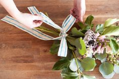3 Unique Floral DIYs — Courtesy Of Two Petal Pros! #refinery29  http://www.refinery29.com/46517#slide-30  Step 10: Wrap the ribbon around the stems to hide the floral tape, and tie into a knot. Finish it off with a bow. ...