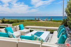 Vanishing pocket doors seamlessly marry the indoor/outdoor entertaining space with spa, fire pit & grassy yard that flow into the coveted Broad Beach sands.