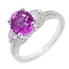 Pink Sapphire Pave Diamond Platinum Ring Older cut 1920 hot pink sapphire VS clarity. 80 rounded diamonds approximate weight .40 cts, 1 Oval pink sapphire 2.37 cts